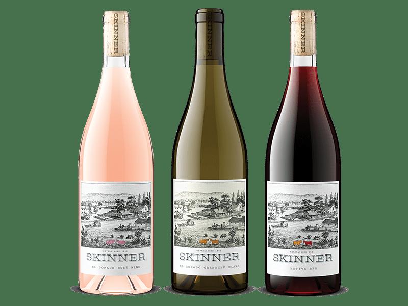 Three bottles of Skinner wine including El Dorado Rose Wine, El Dorado Grenache Blanc, and Native Red