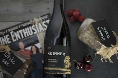 A bottle of Skinner wine with berries next to it