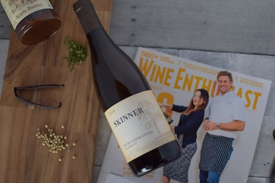 A bottle of Skinner wine on top of the Wine Enthusiast Magazine