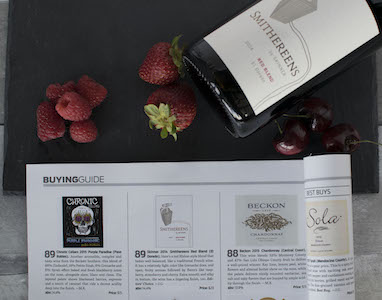 Wine Guide in a table with berries and a bottle of wine