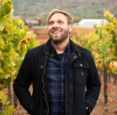 Portrait of Adam smiling standing on Skinner vineyards