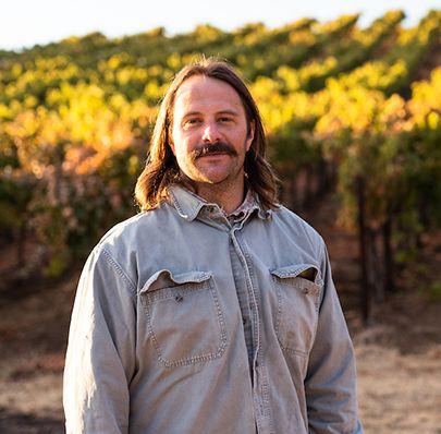 Portrait of Seth standing in front of Skinner vineyards