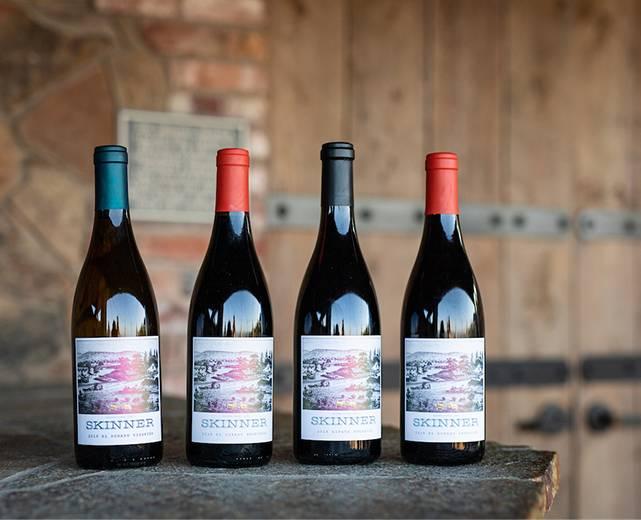 Four Skinner wine bottles